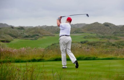 US tycoon Donald Trump plays a stroke as